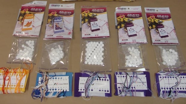 A courier package with five cross stitch patterns also had drugs inside, police say.