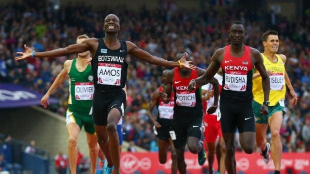 Nijel Amos of Botswana crosses the line to win gold ahead of David Rudisha, right, of Kenya in the men's 800-metre final at the Commonwealth Games.