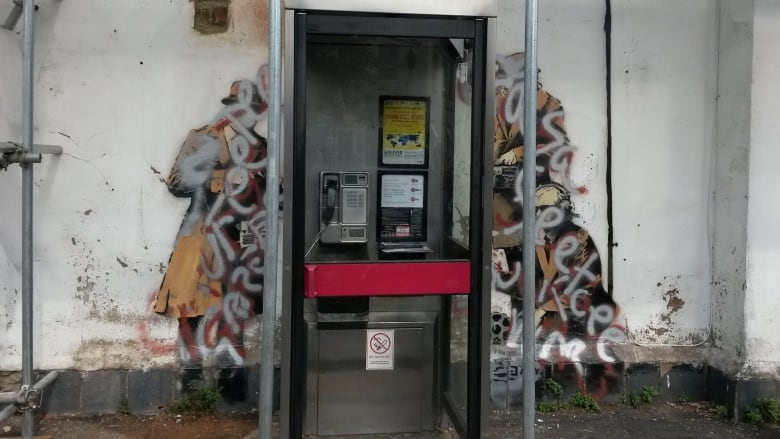 Banksy's Spy Booth artwork defaced in Cheltenham, England