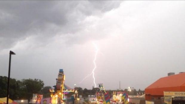 Lightning lights up the sky at the Queen City Ex in Regina Friday night.