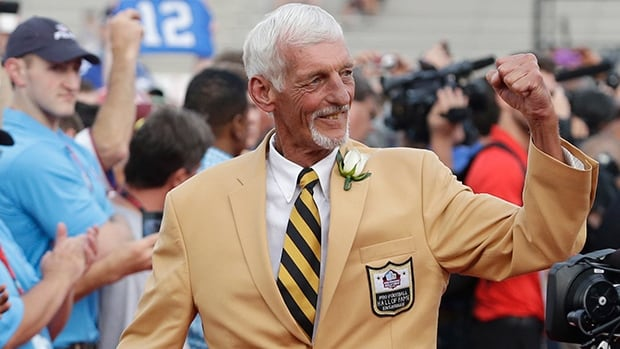 Raiders punter Ray Guy is introduced at the Pro Football Hall of Fame enshrinement ceremony in Canton, Ohio, on Saturday.