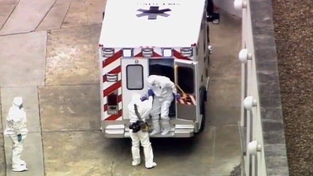 Ebola victim Dr. Kent Brantly exits an ambulance at Emory University Hospital in Atlanta after being flown from Africa.