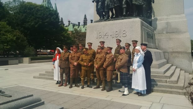Re-enactors of Nova Scotian soldiers pose in Ottawa Sunday.