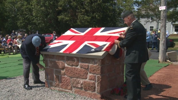 A plaque marking Plug Street in Malpeque as a memorial to every Prince Edward Islander who served in World War I was unveiled Sunday.
