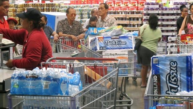 Honolulu residents worried about the landfall of two major storms, including Hurricane Iselle, stocked up on bottled water and other supplies on Tuesday.