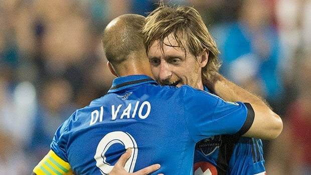 Impact player Marco Di Vaio, front, celebrates with teammate Gorka Larrea after scoring against C.D. Fas during the first half of the CONCACAF Champions League game Tuesday night in Montreal.