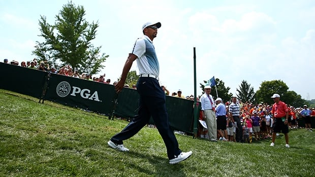Tiger Woods strolls to the practice ground to begin preparing for the PGA Championship at Valhalla Golf Club on Wednesday.