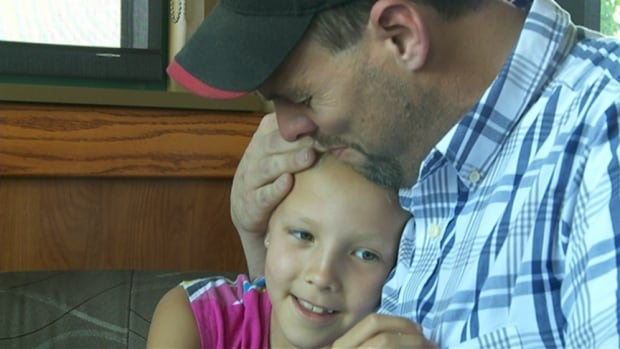 Blake Munro holds his daughter Elya in a Napanee, Ont., restaurant. She and her cousin had been found the day before after a night spent in the eastern Ontario woods.