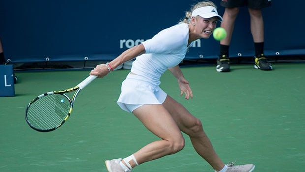 Denmark's Caroline Wozniacki, seen here competing a day earlier, breezed through a second match in a row with a straight sets win over Klara Koukalova on Wednesday at the Rogers Cup event in Montreal.