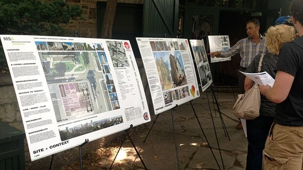 Residents attended a public meeting for The Connolly project on James South on Wednesday. The developer will apply to the city for site plan approval, including approval for its 30 stories, in September.