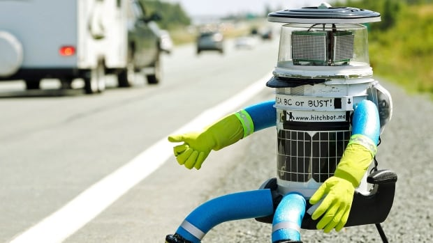 The anthropomorphic robot named hitchBOT, seen here during its cross-Canada trek in 2014, was destroyed on Saturday, two weeks into its attempted trip across the U.S., according to its creators.