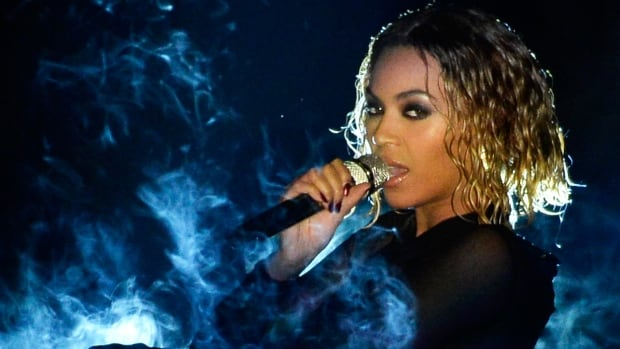 Beyoncé performs onstage during the 56th Grammy Awards in 2014.