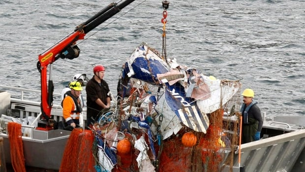 The crew of the San Kawhai was trawling for fish when they brought up a plane in the boat's nets.