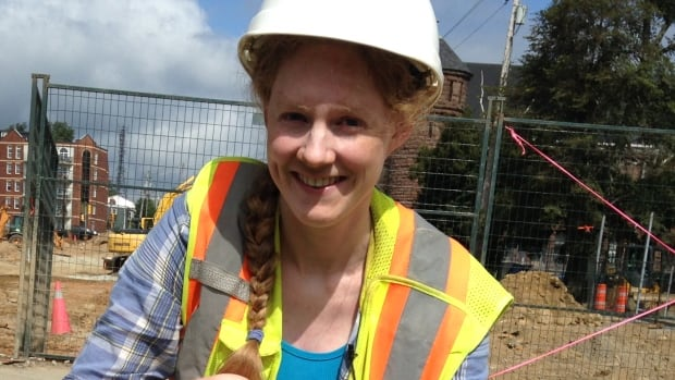 Courtney Glen, senior archaeologist with Davis MacIntyre & Associates, shows some of the items found at the North Park Street construction site.