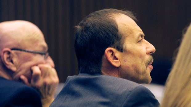 Theodore Wafer, right, listens during closing arguments of his trial on Wednesday.
