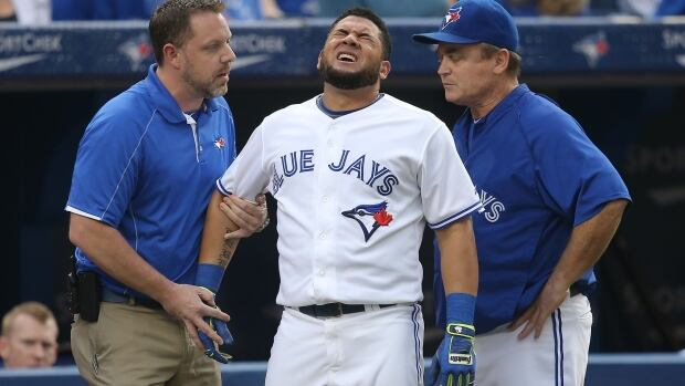 Toronto's Melky Cabrera reacts after being hit by a pitch in the first inning of the Blue Jays' game against Baltimore.