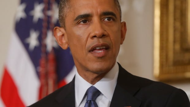 U.S. President Barack Obama authorized targeted air strikes in Iraq to prevent an 'act of genocide' against some 40,000 religious minorities trapped in a remote mountain area.