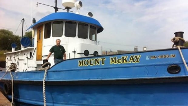 Don Bergholm aboard his restored 1908 tugboat, the Mount McKay