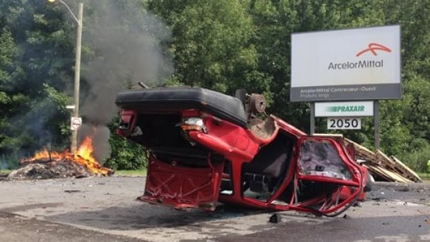 ArcelorMittal Montreal locked nearly 300 employees out of its Contrecoeur, Que., plant this week following tense negotiations. In turn, employees placed an overturned and totalled car along the main road outside the plant and set some debris on fire.