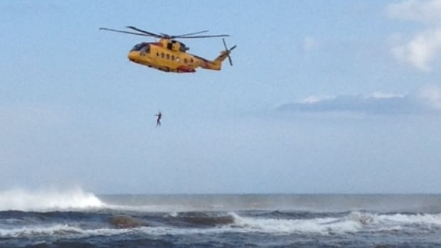 A Coast Guard cormorant helicopter searched for a woman caught in strong surf near Crowbush.