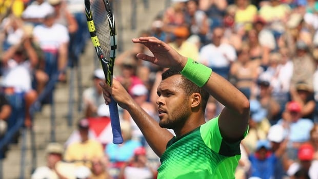 Frenchman Jo-Wilfried Tsonga celebrates his 7-6 (5), 4-6, 6-4 quarter-final win against Andy Murray of Great Britain on Friday in Toronto. Tsonga upended top-ranked Novak Djokovic on Thursday.