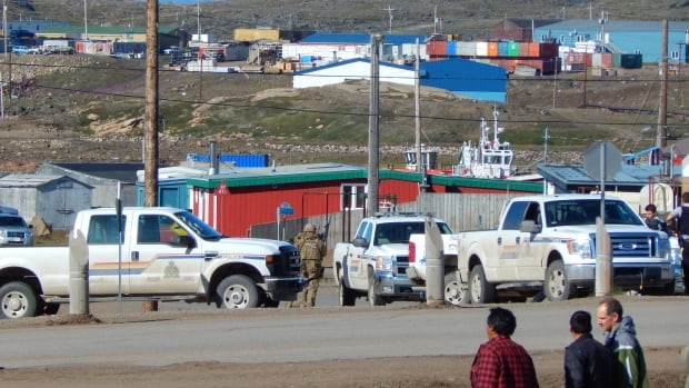Iqaluit RCMP block roads in the 700-block neighbourhood Saturday morning after responding to a call about a distraught man in a home with a gun. Kakee Kootoo, 21, is facing charges including careless use of a firearm.