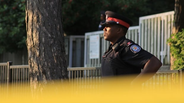 Police is seen at the scene of an early morning stabbing in Etobicoke that left a man dead.