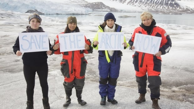 Michelle Thrush and daughter Imajyn Cardinal (middle), and Emma Thompson and daughter Gaia Wise pose on the Smeerenburg glacier on northwest Spitsbergen.