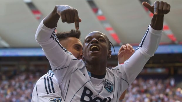 Vancouver Whitecaps forward Darren Mattocks celebrates his goal against Sporting Kansas City in the first half on Sunday.