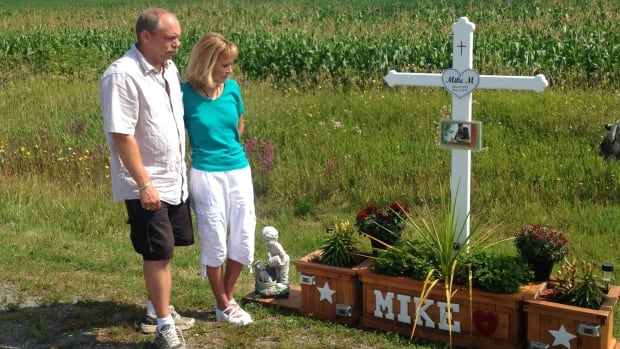 Brian Visneskie and Kathryn Morlang stand at the memorial for their son, Michael Morlang, who was killed in a hit-and-run crash on Aug. 11, 2013.