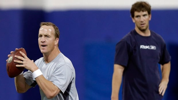 "Denver Broncos quarterback Peyton Manning, left, and brother Eli Manning, quarterback for the New York Giants, have made a sequel to their epic rap video, this one entitled ""Fantasy Football Fantasy."""