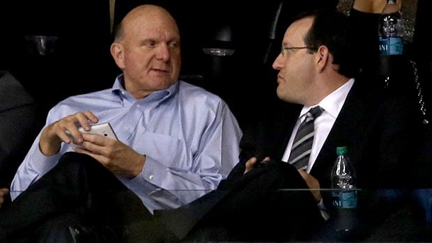 Steve Ballmer, left, sits with AEG head Dan Beckerman at an NHL playoff game in Los Angeles in May.