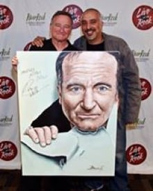 Robin Williams poses with Dave Benning, portraitist