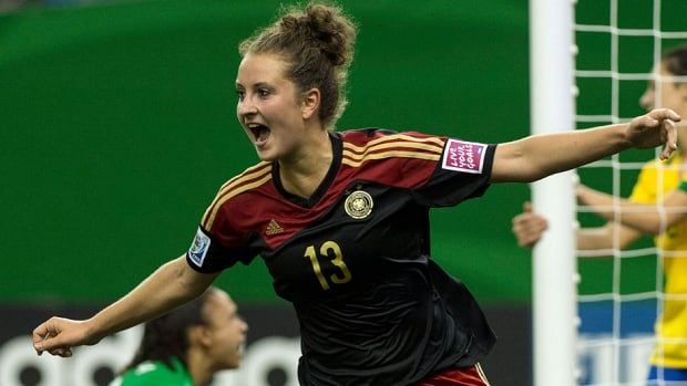 Germany's Sara Daebritz celebrates one of her three goals Tuesday against Brazil at the FIFA U20 Women's World Cup in Montreal. Germany won 5-1 to advance to the quarter-finals.