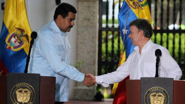 Venezuela's President Nicolas Maduro, left, shook hands with Colombia's President Juan Manuel Santos at a joint appearance in Cartagena on Aug. 1, but relations aren't completely sunny.