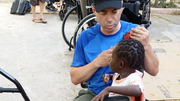 Haitian girl receives first prototype of a prosthetic hand made by a 3D printer