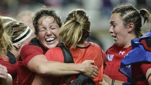 Canadian players react after defeating France 18-16 in the IRB Women's Rugby World Cup semifinal at the Jean Bouin Stadium in Paris on Wednesday. They will meet England in Sunday's final.