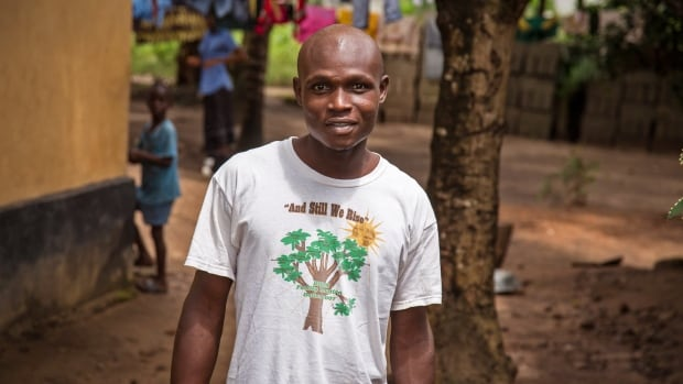 Sulaiman Kemokai, an Ebola virus survivor near his house in Kenema  situated in the Eastern Province around 300 km from the capital city of Freetown in Kenema, Sierra Leone.  Kemokai said earlier this week that he still feels stiffness in his joints but says he is gaining strength each day, nearly a month after his discharge from hospital.