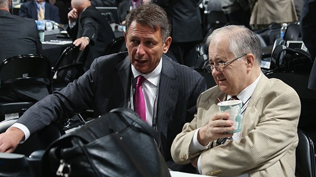 Ken Holland, left, with Red Wings senior vice president Jim Devellano at the 2012 NHL draft, has won three Stanley Cups as Detroit's GM.