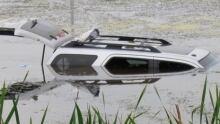 SUV crash in Saskatchewan slough