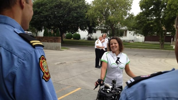 Danielle Berman chats with some members of the Winnipeg Fire and Paramedic Service, who cycled with her Thursday morning for part of her Ride Away Stigma tour.