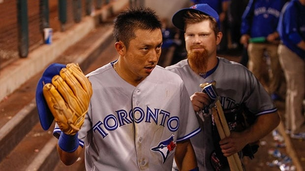 A sweep at the hands of Seattle dealt a serious blow to the post-season hopes of Munenori Kawasaki, left, Adam Lind and the Blue Jays.