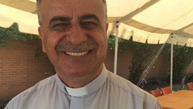 Pastor Sabah is with the new Mesopotamian pavilion at Folk Fest.
