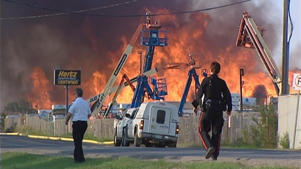 Flames from several grass fires near the train tracks spread to Bob's Discount Pallets in Regina on August 21, 2012.