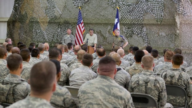 Texas Gov. Rick Perry speaks at Camp Swift Army National Guard Training facility in Bastrop, Texas, August 13, 2014. Texas has started deploying up to 1,000 Texas National Guard troops to the Mexican border.