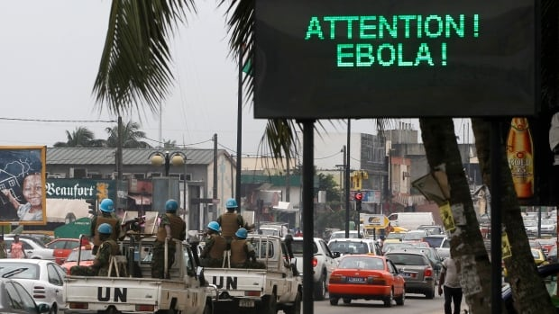 A UN convoy of soldiers drives down a street in Abidjan, Ivory Coast. Three teenage athletes from the Ebola-affected region of Africa will not be allowed to compete at the Youth Olympics in China.