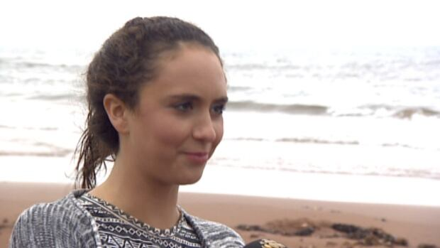 Off-duty lifeguard Kennedy Crossland rescued two children from the surf off a north shore beach Monday.