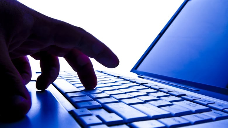 Police arrested a 41-year-old man, saying he extorted and criminally  harassed a woman he met on an online dating site. (Shutterstock)