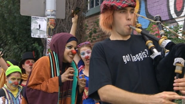 Performers paraded through Old Strathcona Thursday to mark the beginning of the 11-day festival. More than 1,200 artists from around the world are in Edmonton to entertain.