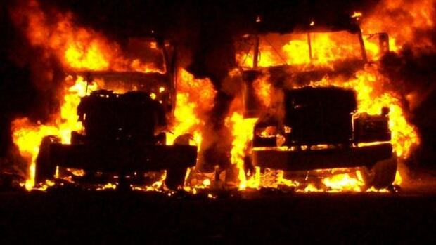 Two boom trucks were engulfed in flames from a fire at a construction yard in Grand Falls-Windsor.